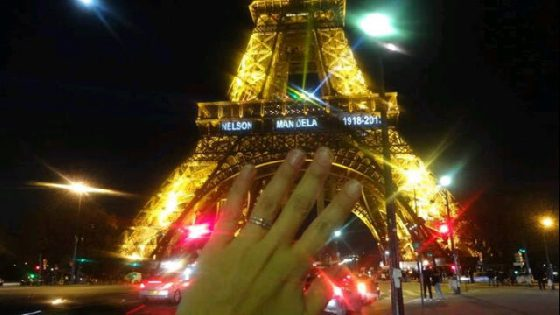 My ring in front of the lit up Eiffel Tower